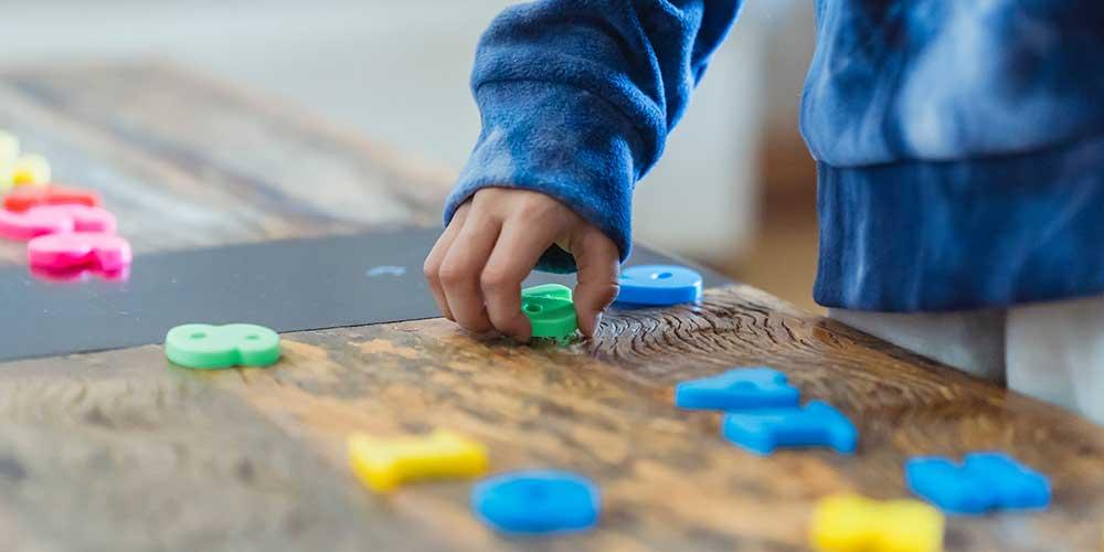 montessori activity child playing with playdough