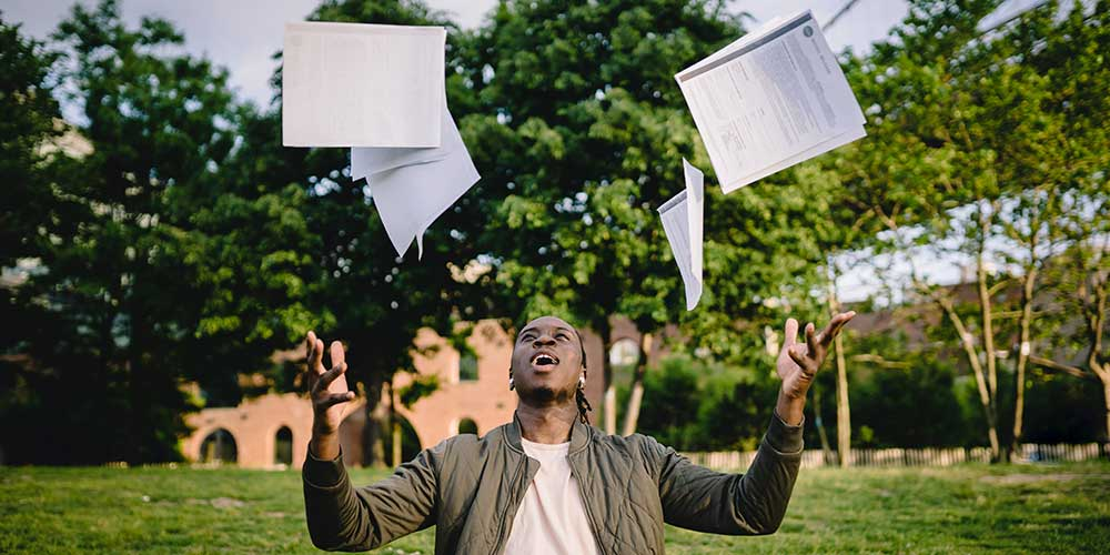 revision strategies: man throwing papers