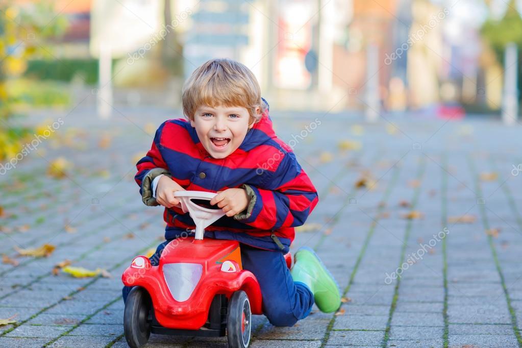 depositphotos_120548778-stock-photo-happy-little-kid-boy-driving